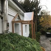 Haustür-Vordach Holz-Glaskonstruktion
